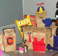 A bunch of puppets, mostly of the paperbag variety.